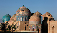 """General view of Mausoleums of the middle group, Shah-I Zinda Complex, from right to left: Unknown mausoleum, Mausoleum of the 1380s,  Octagonal pavilion, dome of the """"double dome mausoleum"""", Samarkand, Uzbekistan, pictured on July 19, 2010, at dawn. The Shah-i-Zinda Complex is a necropolis of mausoleums whose legendary origin dates back to 676 when Kussam-ibn-Abbas arrived to convert the locals to Islam. So successful was he that he was assassinated whilst at prayer. His grave remains the centre of the sacred site which grew over many centuries, especially the 14th and 15th, into an architecturally stunning  example of ceramic art. Samarkand, a city on the Silk Road, founded as Afrosiab in the 7th century BC, is a meeting point for the world's cultures. Its most important development was in the Timurid period, 14th to 15th centuries. Picture by Manuel Cohen."""
