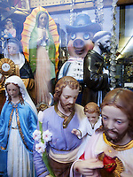 USA. New York City. Queens. Shop selling religious gifts items. Statues of Jesus Christ, the Virgin Mary, a monk, a nun and a fat pig. 21.10.2011 © 2011 Didier Ruef