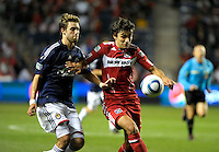 Chicago midfielder Baggio Husidic (9) attempts to shield the ball from Chivas midfielder Blair Gavin (18).  The Chicago Fire tied Chivas USA 1-1 at Toyota Park in Bridgeview, IL on May 1, 2010.
