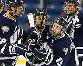 Jeff Silengo (UNH - 18), John Henrion (UNH - 16), Brett Kostolansky (UNH - 15) and Blake Kessel (UNH - 20) celebrate Kostalansky's goal. - The visiting University of New Hampshire Wildcats defeated the University of Massachusetts-Lowell River Hawks 3-0 on Thursday, December 2, 2010, at Tsongas Arena in Lowell, Massachusetts.