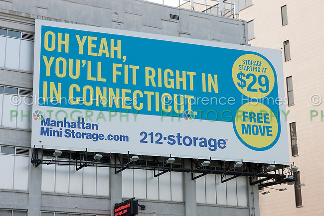 """One of the recent advertisements from New York City based moving and storage company Manhattan Mini Storage. The advertisement, located on one of its storage warehouse facilities on West 44th Street and 12th Avenue, states """"Oh yeah, you'll fit right in in Connecticut"""".  Manhattan Mini Storage is known for its sometimes funny, sometimes provocative ads posted around New York City."""