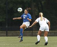 Duke University forward Mollie Pathman (24) traps the ball.Boston College (white) defeated Duke University (blue/white), 4-1, at Newton Campus Field, on October 6, 2013.