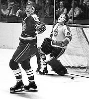 Seals Mike Laughton celebrates goal against Pittsburg Penguins goalie Al Smith. (1970 photo/Ron Riesterer)
