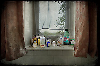 Medicine bottles and bathroom products on the windowsill at Potters Manor House.