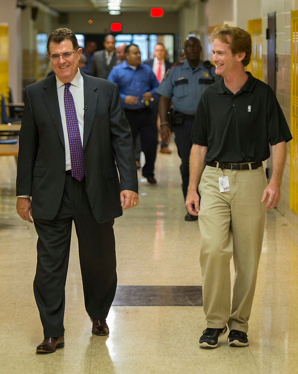 Houston ISD Superintendent Dr. Terry Grier, left, talks with Roy De La Garza, right, while touring MIlby, South Early College and the Jones Futures Academy during first day of school at Jones High School, August 25, 2014.