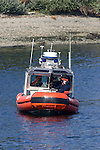 United State Coast Guard Patrol boats perform escort service for the Washington State Ferry System in Seattle on August 20, 2009.  The personnel and boats, from the 13th Coast Guard District, provide protection from possible terrorists attacks in support of the Homeland Security for ferries operating from Seattle area ferry terminals to those on the Kitsap Peninsula, Vashion Island, and Bainbridge Island.    © 2009. All Rights Reserved. Jim Bryant