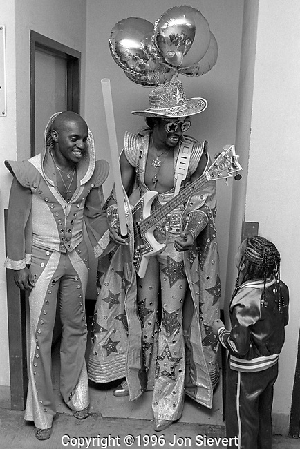 """Gary """"Mudbone"""" Cooper, Bootsy Collins, with young fan, June 2, 1978, Oakland Coliseum, 35-18-28"""