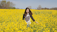 Pretty Young Girl walking in Yellow Flower Meadow