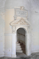 Vestibule with staircase entrance and plaque marking restoration work of 1855, in the Phare de Cordouan or Cordouan Lighthouse, built 1584-1611 in Renaissance style by Louis de Foix, 1530-1604, French architect, located 7km at sea, near the mouth of the Gironde estuary, Aquitaine, France. This is the oldest lighthouse in France. There are 4 storeys, with keeper apartments and an entrance hall, King's apartments, chapel, secondary lantern and the lantern at the top at 68m. Parabolic lamps and lenses were added in the 18th and 19th centuries. The lighthouse is listed as a historic monument. Picture by Manuel Cohen