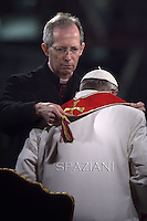 Pope Francis Monsignor Marini.holds the wooden cross during the Via Crucis (Way of the Cross) torchlight procession on Good Friday in front of the Colosseum in Rome. .April 4, 2015