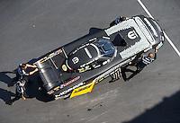 Sep 17, 2016; Concord, NC, USA; Crew members with NHRA funny car driver Matt Hagan during qualifying for the Carolina Nationals at zMax Dragway. Mandatory Credit: Mark J. Rebilas-USA TODAY Sports