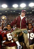 TALLAHASSEE, FL. 10/25/03-FSU Coach Bobby Bowden is carried onto the field by players Michael Boulware, left and Travis Johnson after he won his 339th career game making him the winningest active Division 1A Coach after the Seminoles beat Wake Forest 48-24  Saturday at Doak Campbell Stadium in Tallahassee. COLIN HACKLEY PHOTO