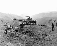 U.S. Marines wounded at Kari San Mountain are evacuated via helicopter and flown to hospital in near areas for treatment.  Navy Corpsmen prepare three wounded Marines for evacuation.  May 23, 1951.  N.H. McMasters.  (Navy)<br /> NARA FILE #  080-G-429571<br /> WAR &amp; CONFLICT BOOK #:  1453
