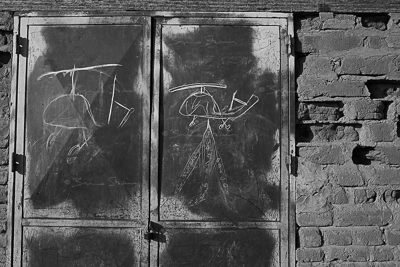 Birac, Eastern Tchad, June 19, 2004.A child drawing on the door of the school shows helicopter gunship bombing, strongly suggesting the Sudanese Air Force is giving air support to the Janjavid militia operations against civilians.
