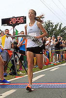 Rachel Ward finished in under 21 minute to win the 32nd annual Charlottesville Women's Four Miler race Saturday in Charlottesville, VA. Photo/The Daily Progress/Andrew Shurtleff