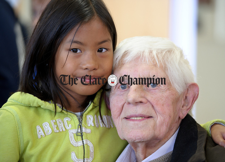 Maria Clune with her grand dad Gerard Clune during Grandparents day at Feakle National School. Photograph by John Kelly.