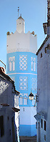 Minaret with blue and white stucco facade viewed through a narrow street in the medina or old town of Chefchaouen in the Rif mountains of North West Morocco. Chefchaouen was founded in 1471 by Moulay Ali Ben Moussa Ben Rashid El Alami to house the muslims expelled from Andalusia. It is famous for its blue painted houses, originated by the Jewish community, and is listed by UNESCO under the Intangible Cultural Heritage of Humanity. Picture by Manuel Cohen
