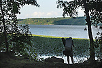 A Photographer taking a photo of the Hudson River from shoreside along the Fr. Charles Jorn Trail in Falling Waters Preserve, Saugerties, NY on Tuesday, August 2, 2011. Photo by Jim Peppler. Copyright Jim Peppler/2011.
