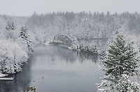 A wintery view of the old County Road 510 bridge during a mid-May snowfall. Marquette, MI