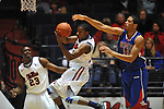 Ole Miss' Jarvis Summers(32) grabs a rebound in front of Ole Miss' Reginald Buckner (23) and SMU's Cannen Cunningham (15) at the C.M. &quot;Tad&quot; Smith Coliseum in Oxford, Miss. on Tuesday, January 3, 2012. Ole Miss won 50-48.