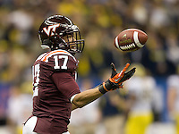 Kyle Fuller of Virginia Tech intercepts the ball away from Michigan during Sugar Bowl game at Mercedes-Benz SuperDome in New Orleans, Louisiana on January 3rd, 2012.  Michigan defeated Virginia Tech, 23-20 in first overtime.