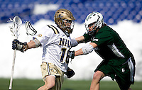 Taylor Cook (16) of Navy is checked by Josh Hawkins (5) of Loyola at the Navy-Marine Corp Memorial Stadium in Annapolis, Maryland.   Loyola defeated Navy, 8-7, in overtime.