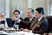 United States President Ronald Reagan leads the discussion during an Economic Policy Council meeting in the Cabinet Room on Wednesday, December 17, 1986.  Also shown, from left: Dr. Beryl Sprinkel, Chairman, President's Council of Economic Advisors; U.S. Secretary of Energy John Herrington; and U.S. Secretary of the Treasury James A. Baker, III..Mandatory Credit: Pete Souza - White House via CNP