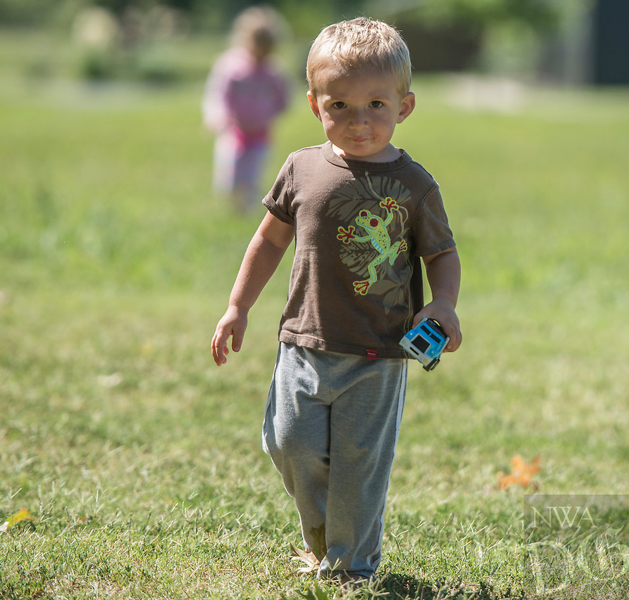 NWA Democrat-Gazette/ANTHONY REYES &bull; @NWATONYR<br /> Silas Roberts, 2, of Fayetteville, plays in a field Friday Sept. 2, 2016 near Tyson Sports Complex in Springdale. Silas played in the field with friends after a picnic lunch with their mothers on a pleasant afternoon.