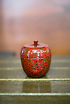 Photo shows samples of Tsugaru lacquerware products on sale at Tanaka-ya in Hirosaki, Japan on 18 Jan. 2013. The product shown is a modern take on an old-style tea container. Photo: Robert Gilhooly..