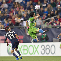 Seattle Sounders midfielder Servando Carrasco (23) heads the ball. In a Major League Soccer (MLS) match, the Seattle Sounders FC defeated the New England Revolution, 2-1, at Gillette Stadium on October 1, 2011.