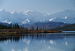 The Alaska Range reflected in the serene Wonder Lake, Denali National Park, Alaska