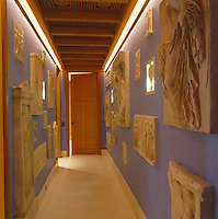 The walls of the narrow entrance corridor are lined with casts of friezes from the National Archaeological Museum in Athens