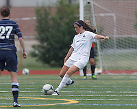 Boston Aztec defender Chelsea Roche (15) passes the ball.  In a Women's Premier Soccer League (WPSL) match, Boston Aztec (white) defeated Seacoast United Phantoms (blue), 3-0, at North Reading High School Stadium on Arthur J. Kenney Athletic Field on on June 25, 2013.