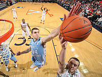 Jan. 8, 2011; Charlottesville, VA, USA;  North Carolina Tar Heels forward Tyler Zeller (44) blocks the shoot over Virginia Cavaliers forward Will Regan (4) during the game at the John Paul Jones Arena. North Carolina won 62-56. Mandatory Credit: Andrew Shurtleff