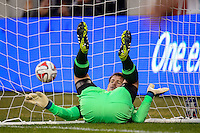 Chivas USA goalkeeper Dan Kennedy (1) falls back into the net after tipping a ball over the bar. The New York Red Bulls and Chivas USA played to a 1-1 tie during a Major League Soccer (MLS) match at Red Bull Arena in Harrison, NJ, on March 30, 2014.