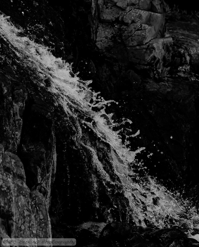 Water stands frozen in time as it falls down a waterfall, with rocks framing the image.  From my hike with Greg in Upper Hot Spring Canyon in the Cleveland National Forest.