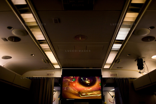 A retina surgery is broadcasted in the theater at the front of the ORBIS Flying Eye Hospital plane for local Vietnamese doctors to study on Wednesday, April 16, 2008.  Kevin German /  kevin@kevingerman.com..ORBIS Flying Eye Hospital brought doctors, nurses and specialists from all over the world to Ho Chi Minh City, Vietnam from April 7-18, 2008.  The ORBIS program contributed to the efforts of Ho Chi Minh City Eye Hospital in fighting avoidable blindness by educating local ophthalmologists to diagnose and manage pediatric blindness, retinal disease, oculoplastics, and blindness due to glaucoma..