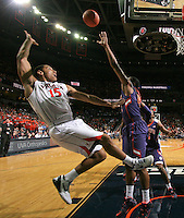 Virginia guard Malcolm Brogdon (15) puts in a fade away shot over Clemson guard Damarcus Harrison (21) during the first half of the game Tuesday Jan. 13, 2015 in Charlottesville, VA. Virginia won 65-42. Photo/Andrew Shurtleff