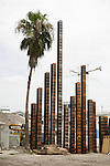 ©2006 David Burnett / Contact Press Images.July 29, 2006.A lone palm tree and iron pilings driven in a downtown neighborhood (near I-4) where construction will take place in the future..Orlando, Florida