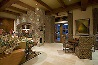 Mediterranean decore family room with beamed ceiling and beautiful built-in cabinets and French doors