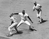 San Francisco Giants slugger Willlie McCovey is caught in a rundown between first and second base. St.Louis Cardinal 1st baseman Orlando Cepeda attempts tag but drops the ball..(1968 photo by Ron Riesterer)