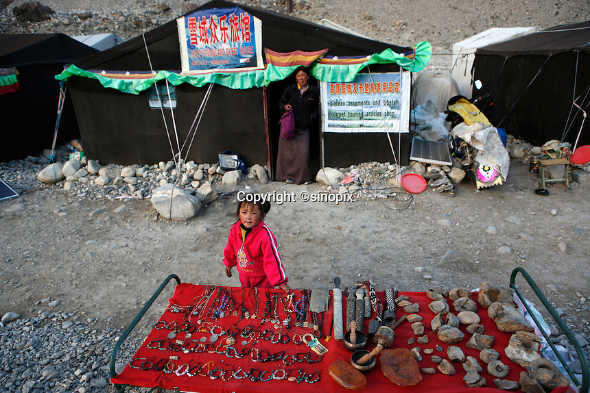 A tent owner and her daughter stands in front his tent guest house at the tent village near Everest base camp.<br /> China started building a controversial 67-mile &quot;paved highway fenced with undulating guardrails&quot; to Mount Qomolangma, known in the west as Mount Everest, to help facilitate next year's Olympic Games torch relay.