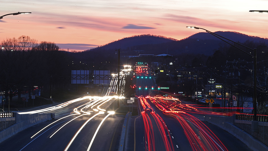 Traffic streams down U.S. 29 as the sun sets over Charlottesville, Va. Photo/Andrew Shurtleff Photography, LLC