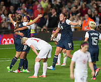 Manchester, England - Monday, August 6, 2012: The USA defeated Canada 4-3 in overtime in the semi-final round of the 2012 London Olympics at Old Trafford. Abby Wambach celebrates with Alex Morgan and Sydney Leroux after Morgan's game winning goal.