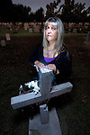 Ghost whisperer Debe Branning listens to the spirits at a Mesa,AZ graveyard.