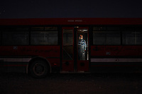 Nagla Mohamed Lamin, 20. Pictured on a bus near Smara refugee camp, Algeria: 'It's difficult because when you start to know that this place doesn't belong to you it is always in your mind. At the same time we will miss this place because we are born here. We used to say when we are in our homeland we will return here to visit and if our house has fallen down we will say: 'I used to live there!' We would say it will be next year and every year after we would say: 'It will happen next year'. When I grew up I started to realise that this issue is very complicated and we don't know when we will go back, but we are sure that we will go one day. I have many dreams, the first to complete my English studies, I want to help my people, even in a small way, but just to do something. I would like to travel to different countries to talk about the Saharawi situation, to let people know about us, that's why I study English because English is the language of the world.' .