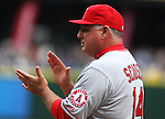 Los Angeles Angels manager Mike Scioscia claps as his players are introduced before their game with the Seattle Mariners before their season home opener April 6, 2015 at Safeco Field in Seattle.  The Mariners beat the Angels 4-1.    ©2015. Jim Bryant Photo. ALL RIGHTS RESERVED.