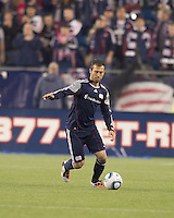 New England Revolution defender A.J. Soares (5) brings the ball forward. In a Major League Soccer (MLS) match, the New England Revolution tied the Colorado Rapids, 0-0, at Gillette Stadium on May 7, 2011.
