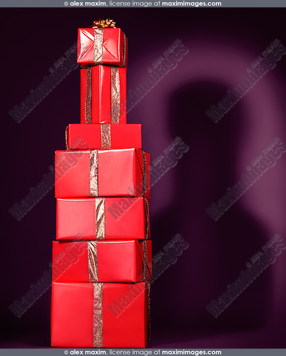 Pile of red presents, gift boxes, stacked in a shape of a bottle. Alcoholic beverage holiday concept.
