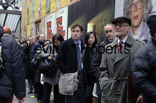 Hundreds of people line up in New York on Wednesday, February 18. 2009 for a job fair sponsored by National Career Fairs. The Department of Labor will release their  weekly jobless claim figures on Thursday. (© Frances M. Roberts)